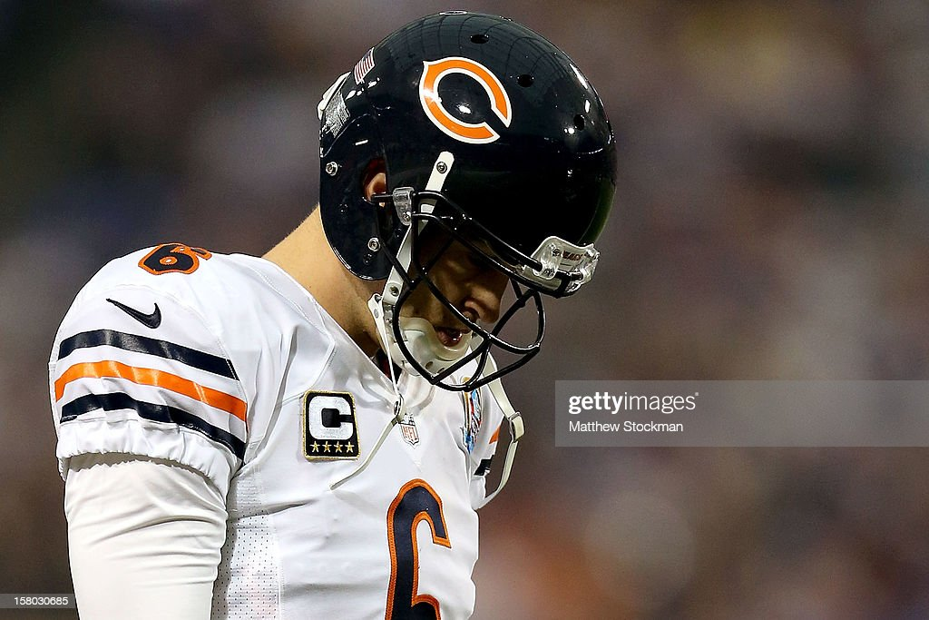 Quarterback <a gi-track='captionPersonalityLinkClicked' href=/galleries/search?phrase=Jay+Cutler&family=editorial&specificpeople=622249 ng-click='$event.stopPropagation()'>Jay Cutler</a>#6 of the Chicago Bears walks back to the huddle after throwing a incomplete pass against the Minnesota Vikings at Mall of America Field on December 9, 2012 in Minneapolis, Minnesota.