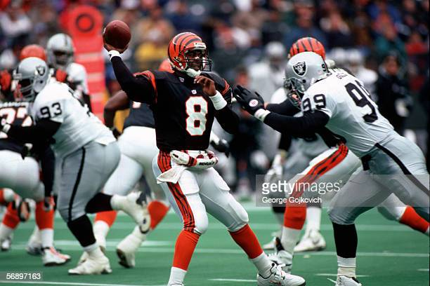 Quarterback Jeff Blake of the Cincinnati Bengals passes while under pressure from defensive end Aundray Bruce of the Oakland Raiders at Riverfront...