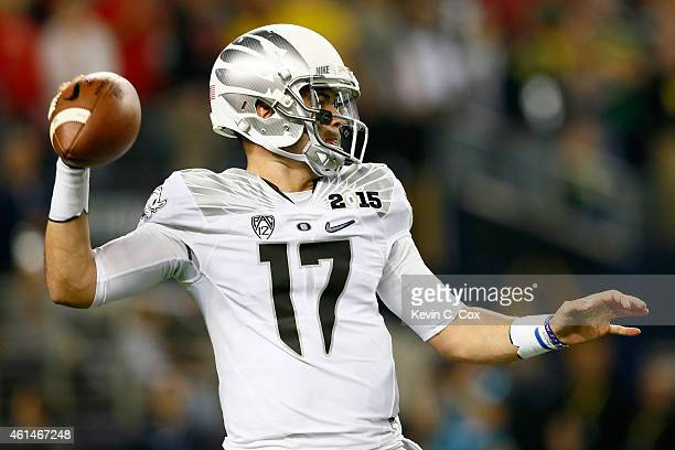Quarterback Jeff Lockie of the Oregon Ducks passes the ball in the second half during the College Football Playoff National Championship Game at ATT...