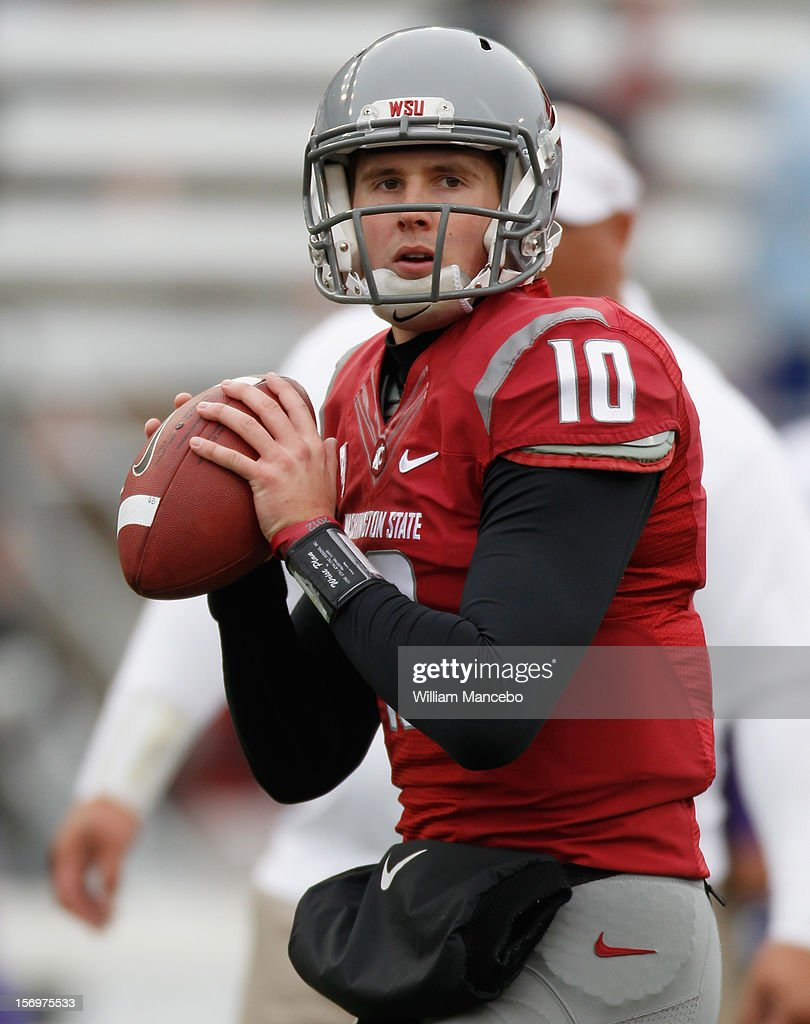 Quarterback Jeff Tuel #10 of the Washington State Cougars during warm ups prior to the start of the Apple Cup game against the Washington Huskies at Martin Stadium on November 23, 2012 in Pullman, Washington.