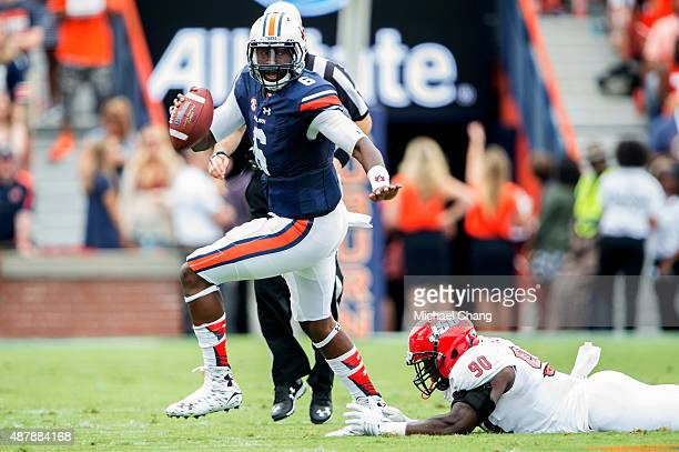 Quarterback Jeremy Johnson of the Auburn Tigers scrambles to avoid a tackle by defensive end Chris Landrum of the Jacksonville State Gamecocks on...