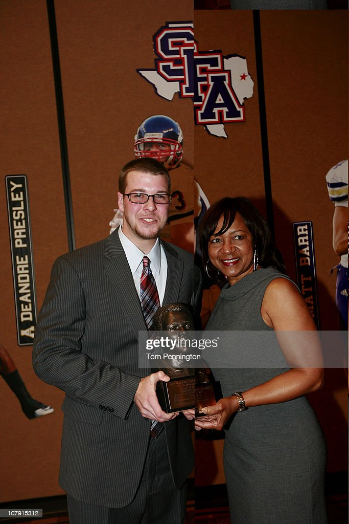 Quarterback Jeremy Moses, of Stephen F. Austin University, celebrates with Connie Payton, wife of Walter Payton, after winning the 2010 Walter Payton Award during the 24th Annual Football Championship Subdivision Awards on January 6, 2011 in Frisco, Texas.