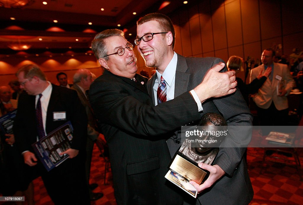 Quarterback Jeremy Moses (R) of Stephen F. Austin University, is congratulated by Stephen F. Austin Athletic Director Robert Hill after Moses won the 2010 Walter Payton Award during the 24th Annual Football Championship Subdivision Awards on January 6, 2011 in Frisco, Texas.