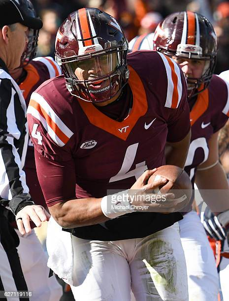 Quarterback Jerod Evans of the Virginia Tech Hokies reacts after his touchdown run against the Virginia Cavaliers in the first half at Lane Stadium...