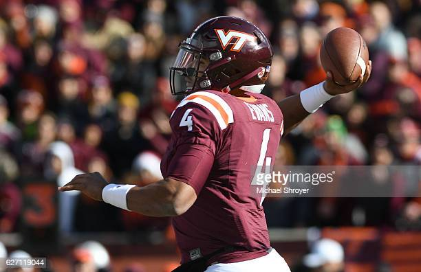 Quarterback Jerod Evans of the Virginia Tech Hokies throws against the Virginia Cavaliers in the first half at Lane Stadium on November 26 2016 in...