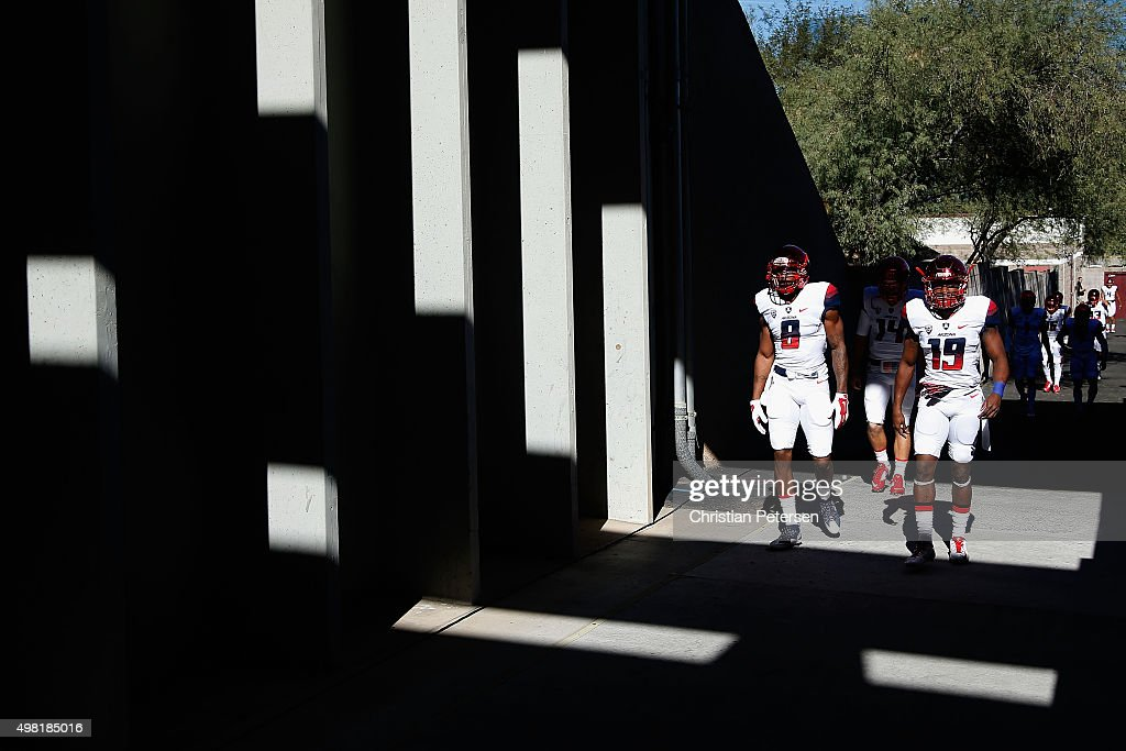 Quarterback Jerrard Randall #8 and cornerback DaVonte' Neal #19 of the Arizona Wildcats walk out onto the field before the college football game against the Arizona State Sun Devils at Sun Devil Stadium on November 21, 2015 in Tempe, Arizona.