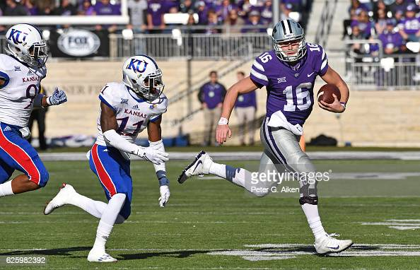 Quarterback Jesse Ertz of the Kansas State Wildcats rushes up field against safety Mike Lee of the Kansas Jayhawks during the first half on November...