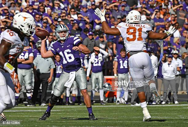 Quarterback Jesse Ertz of the Kansas State Wildcats throws a pass against pressure from defensive end Bryce Cottrell of the Texas Longhorns during...