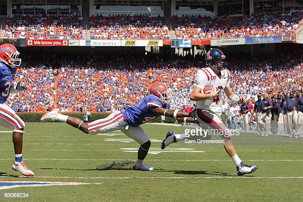 Quarterback Jevan Snead Mississippi Rebels runs the ball during the game against the Florida Gators during the game at Ben Hill Griffin Stadium on...