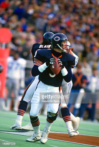 Quarterback Jim McMahon of the Chicago Bears drops back to pass against the Detroit Lions during an NFL football game at Soldier Field circa 1987 in...