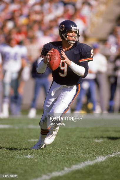Quarterback Jim McMahon of the Chicago Bears drops back to pass against the Dallas Cowboys at Soldier Field on October 16 1988 in Chicago Illinois...