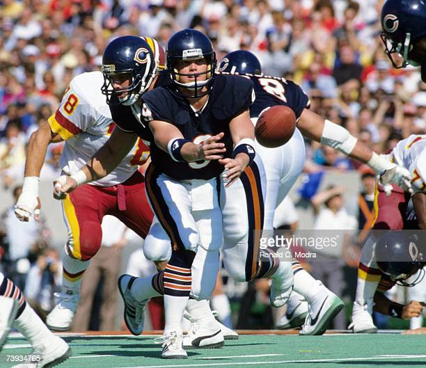 Quarterback Jim McMahon of the Chicago Bears tosses the ball in a game against the Washington Redskins on September 29 1985 in Chicago Illinois