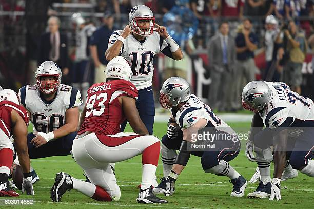 Quarterback Jimmy Garoppolo of the New England Patriots calls a play on the line of scrimmage in the first quarter of the NFL game against the...