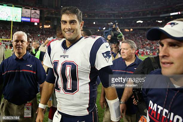 Quarterback Jimmy Garoppolo of the New England Patriots celebrates after defeating the Arizona Cardinals 2321 in the NFL game at the University of...