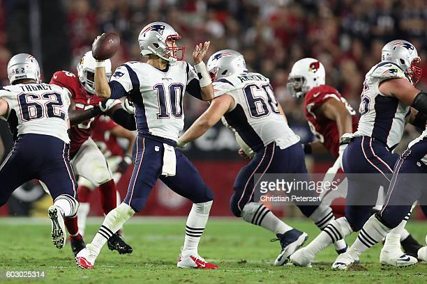 Quarterback Jimmy Garoppolo of the New England Patriots throws a pass during the fourth quarter of the NFL game against the Arizona Cardinals at the...