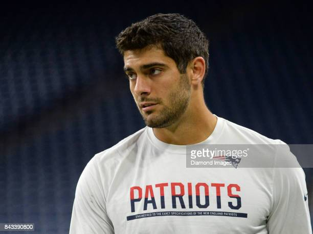 Quarterback Jimmy Garoppolo of the New England Patriots walks onto the field prior to a preseason game on August 25 2017 against the Detroit Lions at...