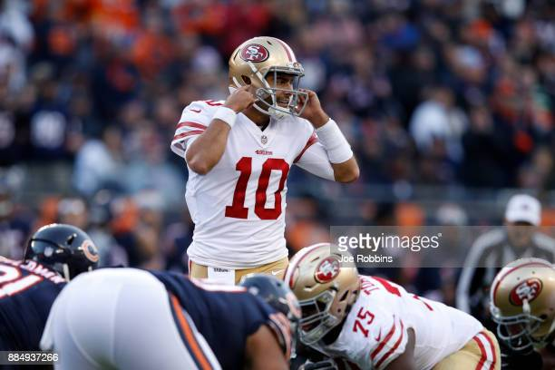 Quarterback Jimmy Garoppolo of the San Francisco 49ers prepares for the snap in the fourth quarter against the Chicago Bears at Soldier Field on...