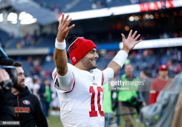 Quarterback Jimmy Garoppolo of the San Francisco 49ers reacts after the 49ers defeated the Chicago Bears 1514 at Soldier Field on December 3 2017 in...