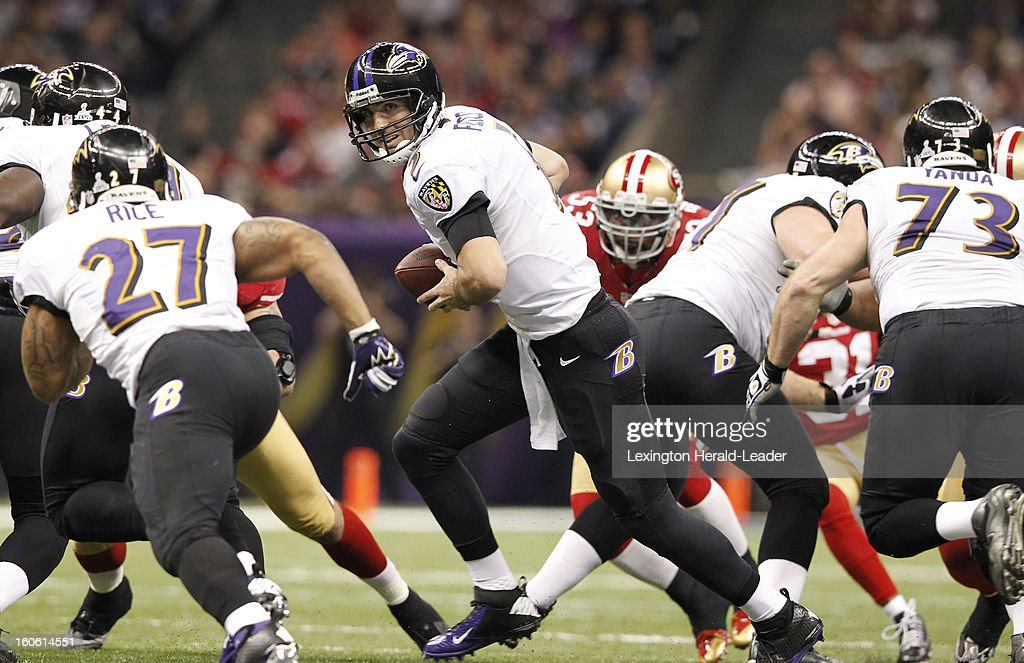 Quarterback Joe Flacco, middle, of the Baltimore Ravens in first-quarter action as the San Francisco 49ers in Super Bowl XLVII at the Mercedes-Benz Superdome in New Orleans, Louisiana, Sunday, February 3, 2013.