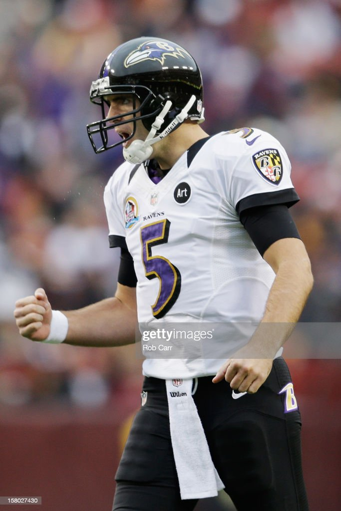 Quarterback Joe Flacco #5 of the Baltimore Ravens celebrates after throwing a first half touchdown pass against the Washington Redskins at FedExField on December 9, 2012 in Landover, Maryland.