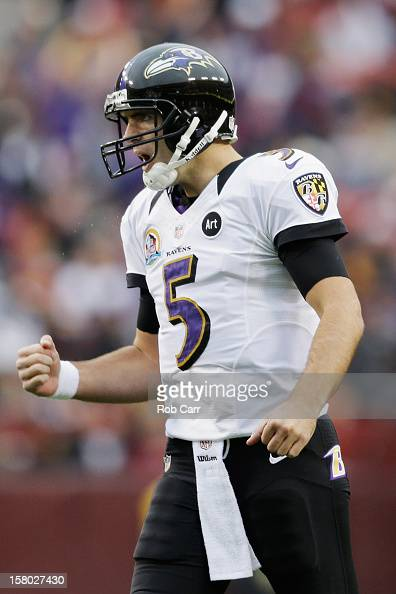 Quarterback Joe Flacco of the Baltimore Ravens celebrates after throwing a first half touchdown pass against the Washington Redskins at FedExField on...