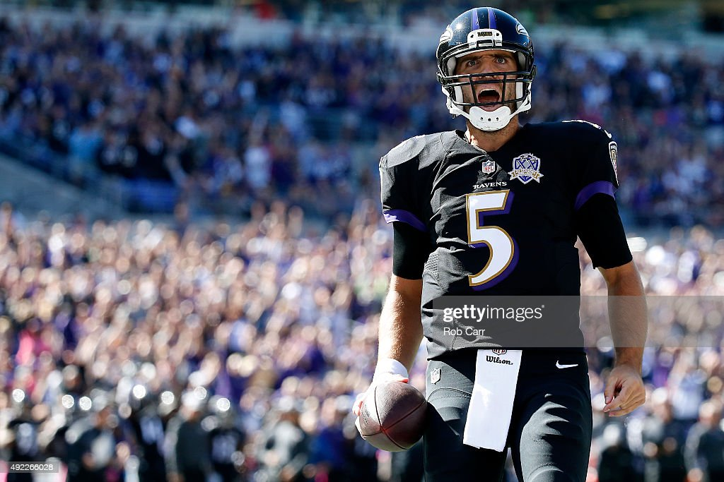 Quarterback <a gi-track='captionPersonalityLinkClicked' href=/galleries/search?phrase=Joe+Flacco&family=editorial&specificpeople=4645672 ng-click='$event.stopPropagation()'>Joe Flacco</a> #5 of the Baltimore Ravens celebrates after scoring a first quarter touchdown during a game against the Cleveland Browns at M&T Bank Stadium on October 11, 2015 in Baltimore, Maryland.