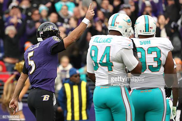 Quarterback Joe Flacco of the Baltimore Ravens celebrates after throwing a second quarter touchdown pass to teammate tight end Dennis Pitta against...