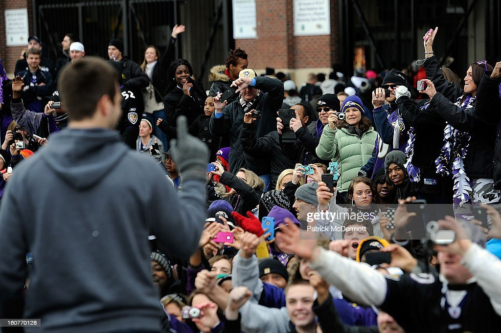 Quarterback Joe Flacco #5 of the Baltimore Ravens celebrates with his teammates as they celebrate during their Super Bowl XLVII victory parade on February 5, 2013 in Baltimore, Maryland. The Baltimore Ravens captured their second Super Bowl title by defeating the San Francisco 49ers.