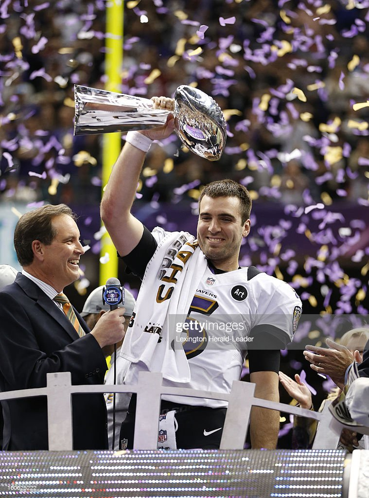 Quarterback Joe Flacco of the Baltimore Ravens celebrates with the Lombardi Trophy after a 34-31 win against the San Francisco 49ers in Super Bowl XLVII at the Mercedes-Benz Superdome in New Orleans, Louisiana, Sunday, February 3, 2013.