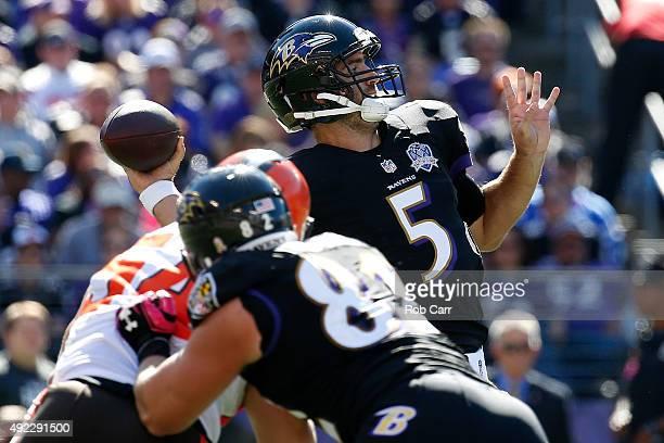 Quarterback Joe Flacco of the Baltimore Ravens drops back to pass while Baltimore Ravens tight end Nick Boyle of the Baltimore Ravens blocks...