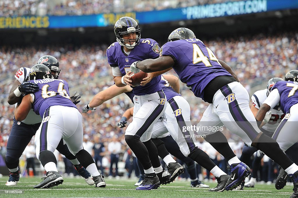 Quarterback <a gi-track='captionPersonalityLinkClicked' href=/galleries/search?phrase=Joe+Flacco&family=editorial&specificpeople=4645672 ng-click='$event.stopPropagation()'>Joe Flacco</a> #5 of the Baltimore Ravens hands off to <a gi-track='captionPersonalityLinkClicked' href=/galleries/search?phrase=Vonta+Leach&family=editorial&specificpeople=2147886 ng-click='$event.stopPropagation()'>Vonta Leach</a> #44 against the Houston Texans at M&T Bank Stadium on September 22, 2013 in Baltimore, Maryland.