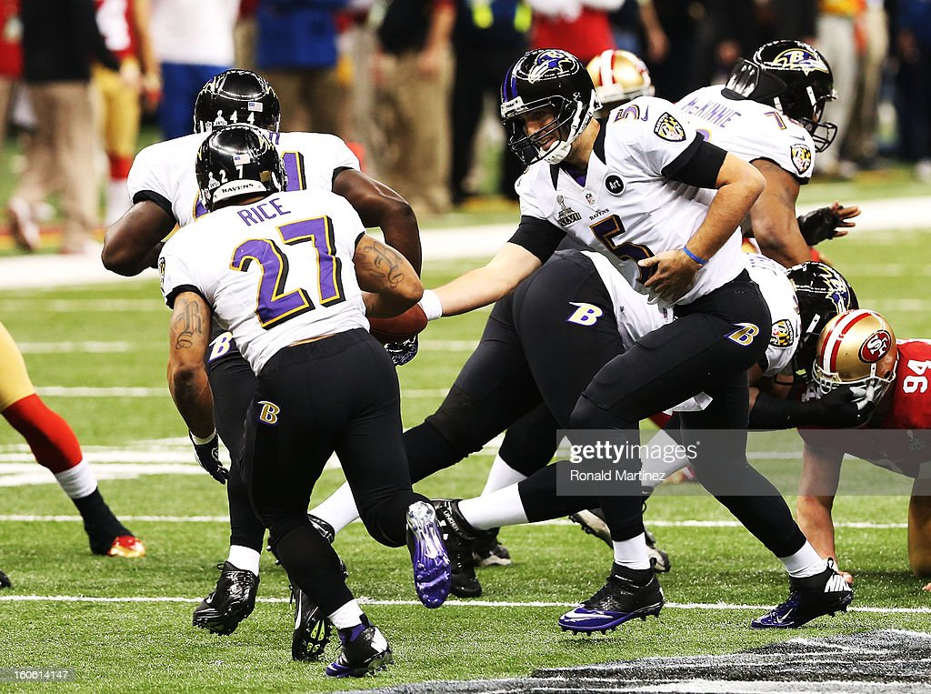 QUarterback Joe Flacco #5 of the Baltimore Ravens hands the ball off to Ray Rice #27 in the first quarter against the San Francisco 49ers during Super Bowl XLVII at the Mercedes-Benz Superdome on February 3, 2013 in New Orleans, Louisiana.
