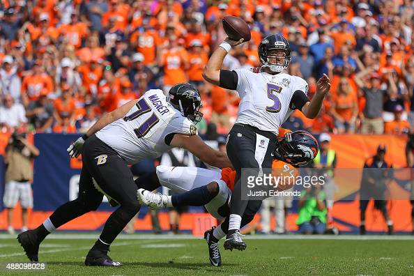 Quarterback Joe Flacco of the Baltimore Ravens is sacked by linebacker DeMarcus Ware of the Denver Broncos as tackle Ricky Wagner attempts to block...