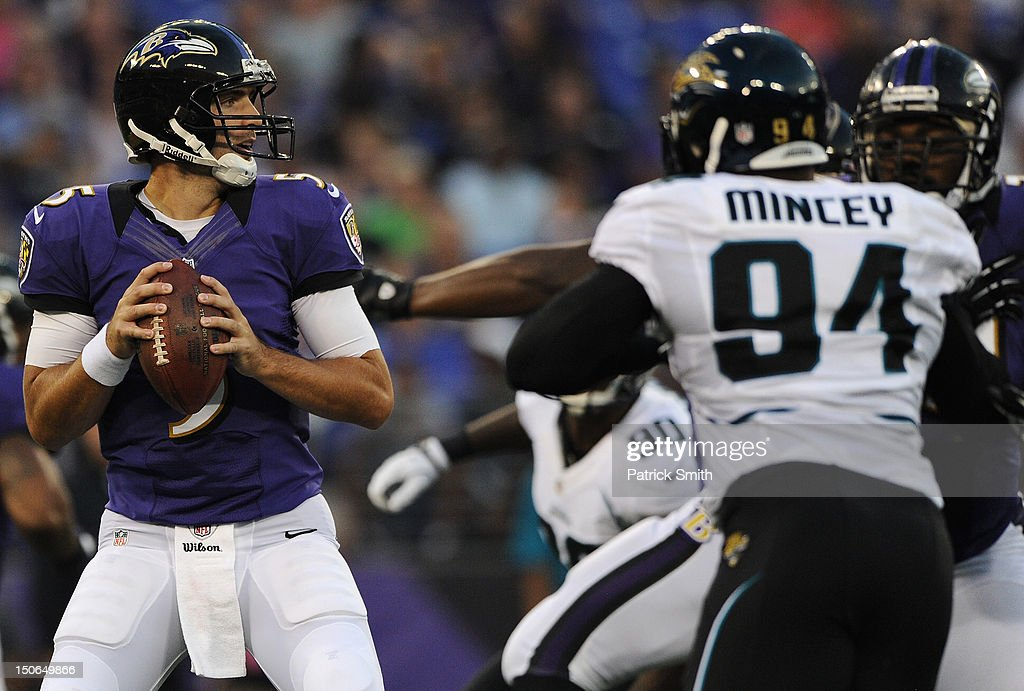 Quarterback <a gi-track='captionPersonalityLinkClicked' href=/galleries/search?phrase=Joe+Flacco&family=editorial&specificpeople=4645672 ng-click='$event.stopPropagation()'>Joe Flacco</a> #5 of the Baltimore Ravens looks for an open teammate against the Jacksonville Jaguars in the first quarter at M&T Bank Stadium on August 23, 2012 in Baltimore, Maryland.