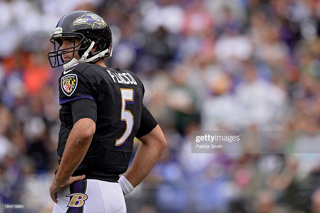 Quarterback <a gi-track='captionPersonalityLinkClicked' href=/galleries/search?phrase=Joe+Flacco&family=editorial&specificpeople=4645672 ng-click='$event.stopPropagation()'>Joe Flacco</a> #5 of the Baltimore Ravens looks on after a penalty was called on the offense against the Green Bay Packers in the third quarter at M&T Bank Stadium on October 13, 2013 in Baltimore, Maryland.