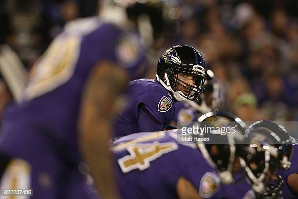 Quarterback Joe Flacco of the Baltimore Ravens looks on from the line of scrimmage against the Cleveland Browns in the first quarter at MT Bank...