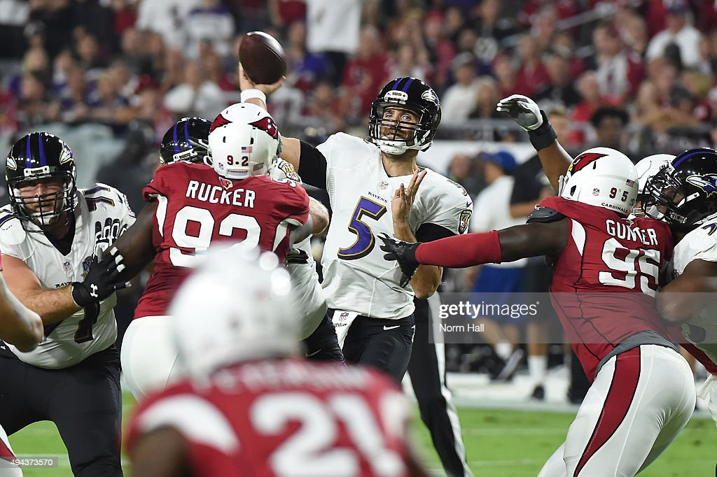 Quarterback <a gi-track='captionPersonalityLinkClicked' href=/galleries/search?phrase=Joe+Flacco&family=editorial&specificpeople=4645672 ng-click='$event.stopPropagation()'>Joe Flacco</a> #5 of the Baltimore Ravens makes a pass in traffic in the first quarter of the NFL game against the Arizona Cardinals at University of Phoenix Stadium on October 26, 2015 in Glendale, Arizona.