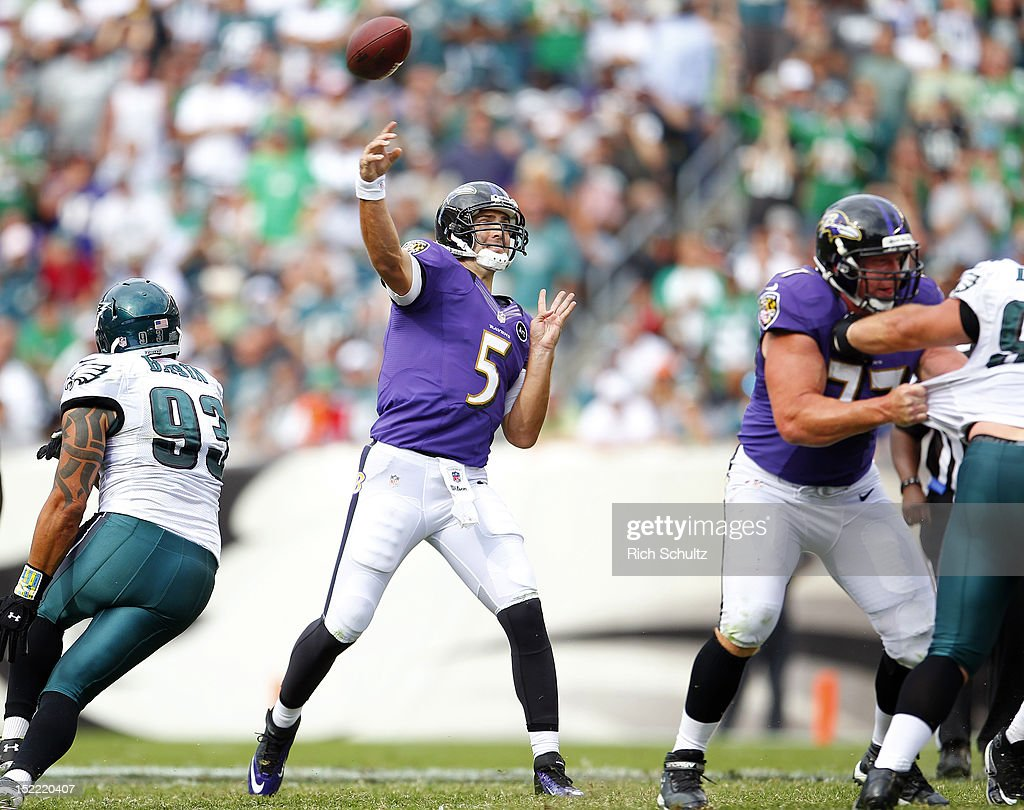 Quarterback <a gi-track='captionPersonalityLinkClicked' href=/galleries/search?phrase=Joe+Flacco&family=editorial&specificpeople=4645672 ng-click='$event.stopPropagation()'>Joe Flacco</a> #5 of the Baltimore Ravens passes against the Philadelphia Eagles during a game at Lincoln Financial Field on September 16, 2012 in Philadelphia, Pennsylvania. The Eagles defeated the Ravens 24-23.