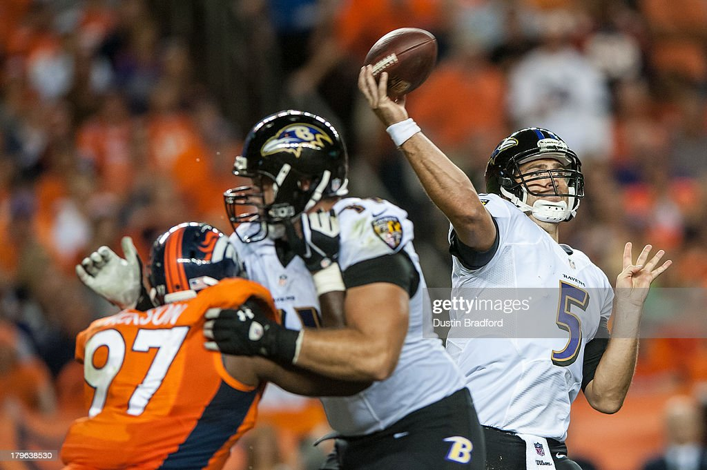 Quarterback <a gi-track='captionPersonalityLinkClicked' href=/galleries/search?phrase=Joe+Flacco&family=editorial&specificpeople=4645672 ng-click='$event.stopPropagation()'>Joe Flacco</a> #5 of the Baltimore Ravens passes against the Denver Broncos during the game at Sports Authority Field at Mile High on September 5, 2013 in Denver Colorado.