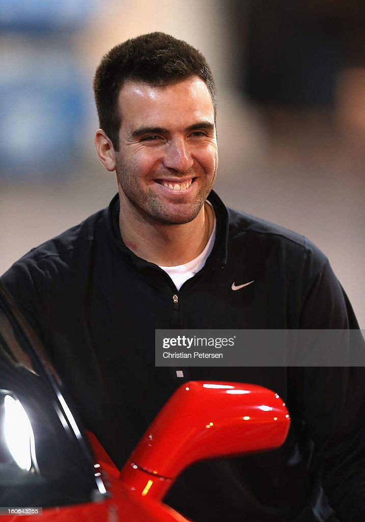 Quarterback <a gi-track='captionPersonalityLinkClicked' href=/galleries/search?phrase=Joe+Flacco&family=editorial&specificpeople=4645672 ng-click='$event.stopPropagation()'>Joe Flacco</a> of the Baltimore Ravens poses with his Chevrolet Corvette during the Super Bowl XLVII Team Winning Coach and MVP Press Conference at the Ernest N. Morial Convention Center on February 4, 2013 in New Orleans, Louisiana.