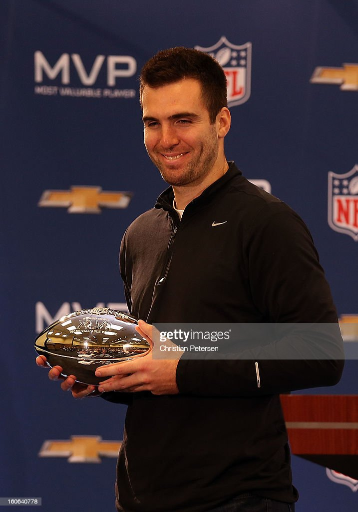 Quarterback <a gi-track='captionPersonalityLinkClicked' href=/galleries/search?phrase=Joe+Flacco&family=editorial&specificpeople=4645672 ng-click='$event.stopPropagation()'>Joe Flacco</a> of the Baltimore Ravens poses with the MVP trophy during the Super Bowl XLVII Team Winning Coach and MVP Press Conference at the Ernest N. Morial Convention Center on February 4, 2013 in New Orleans, Louisiana.