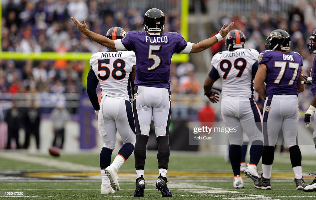 Quarterback <a gi-track='captionPersonalityLinkClicked' href=/galleries/search?phrase=Joe+Flacco&family=editorial&specificpeople=4645672 ng-click='$event.stopPropagation()'>Joe Flacco</a> #5 of the Baltimore Ravens reacts to a play against the Denver Broncos at M&T Bank Stadium on December 16, 2012 in Baltimore, Maryland.