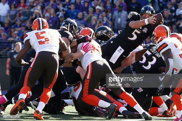 Quarterback Joe Flacco of the Baltimore Ravens scores a third quarter touchdown during a game against the Cleveland Browns at MT Bank Stadium on...
