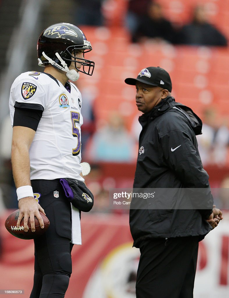 Quarterback Joe Flacco #5 of the Baltimore Ravens talks with quarterbacks coach Jim Caldwell prior to the start of the Ravens game against the Washington Redskins at FedExField on December 9, 2012 in Landover, Maryland.