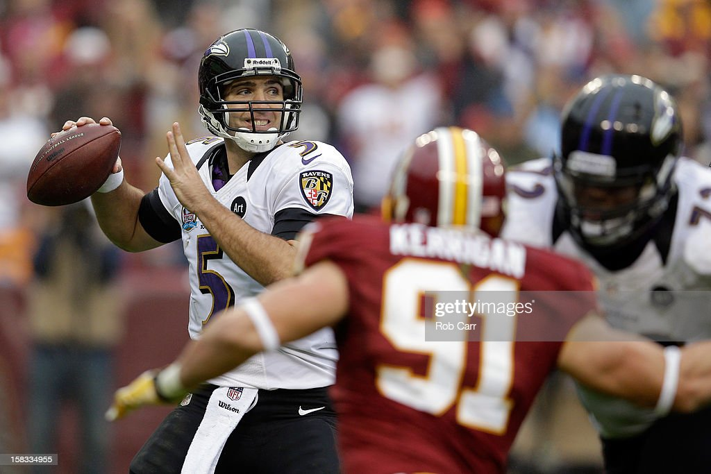 Quarterback <a gi-track='captionPersonalityLinkClicked' href=/galleries/search?phrase=Joe+Flacco&family=editorial&specificpeople=4645672 ng-click='$event.stopPropagation()'>Joe Flacco</a> #5 of the Baltimore Ravens throws a pass against the Washington Redskins at FedExField on December 9, 2012 in Landover, Maryland.