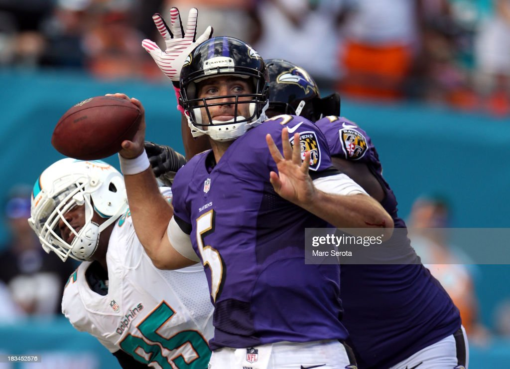 Quarterback <a gi-track='captionPersonalityLinkClicked' href=/galleries/search?phrase=Joe+Flacco&family=editorial&specificpeople=4645672 ng-click='$event.stopPropagation()'>Joe Flacco</a> #5 of the Baltimore Ravens throws against the Miami Dolphins at Sun Life Stadium on October 6, 2013 in Miami Gardens, Florida. The Ravens defeated the Dolphins 26-23.