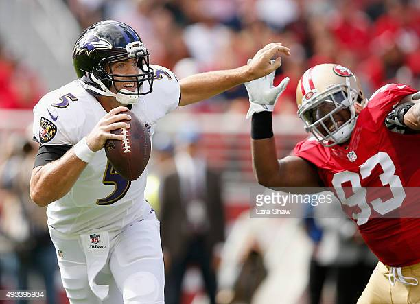 Quarterback Joe Flacco of the Baltimore Ravens tries to get away from nose tackle Ian Williams of the San Francisco 49ers at Levi's Stadium on...