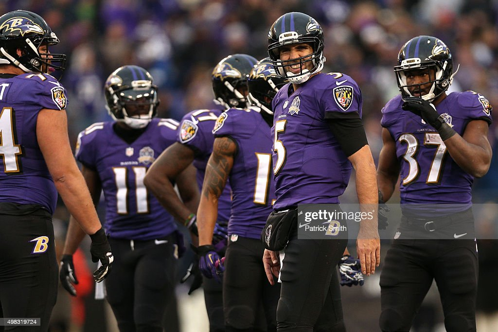 Quarterback Joe Flacco #5 of the Baltimore Ravens winces in pain on the final drive of the fourth quarter against the St. Louis Rams at M&T Bank Stadium on November 22, 2015 in Baltimore, Maryland. The Baltimore Ravens won, 16-13.