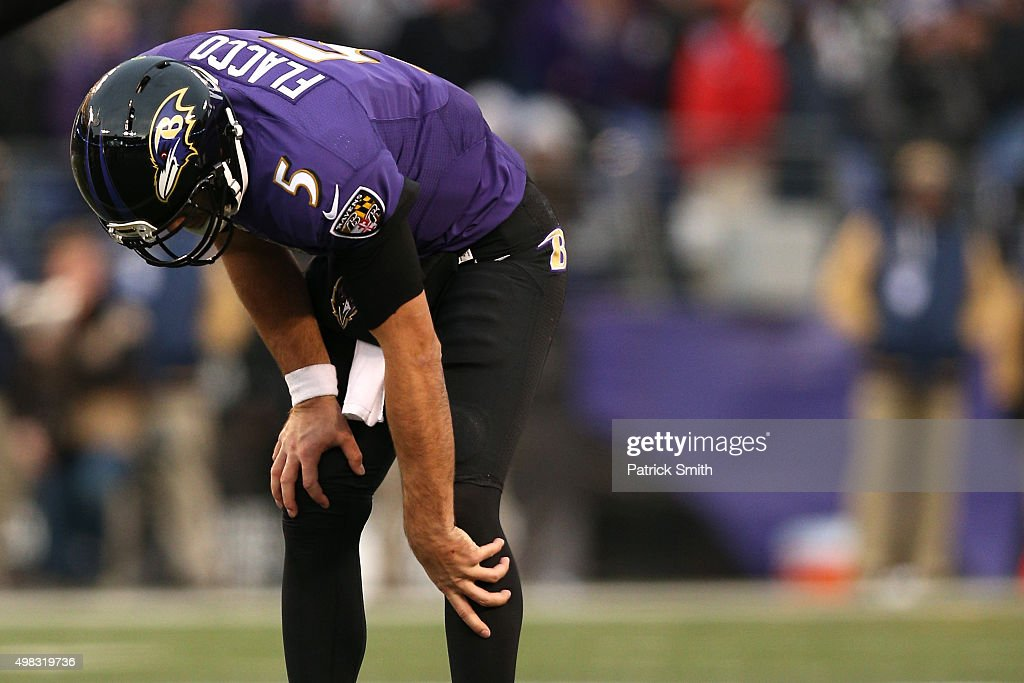 Quarterback Joe Flacco of the Baltimore Ravens winces in pain on the final drive of the fourth quarter against the St Louis Rams at MT Bank Stadium...