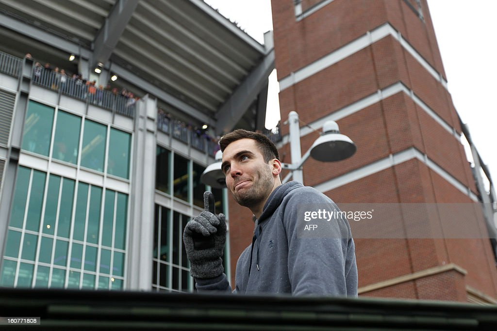 Quarterback Joe Flacco of the Super Bowl champion Baltimore Ravens greets fans during the Ravens victory parade and rally in Baltimore, Maryland on February 5, 2013. The Ravens defeated the San Francisco 49's 34-31 to win the NFL Championship in New Orleans, on February 3, 2013. AFP PHOTO/Molly RILEY